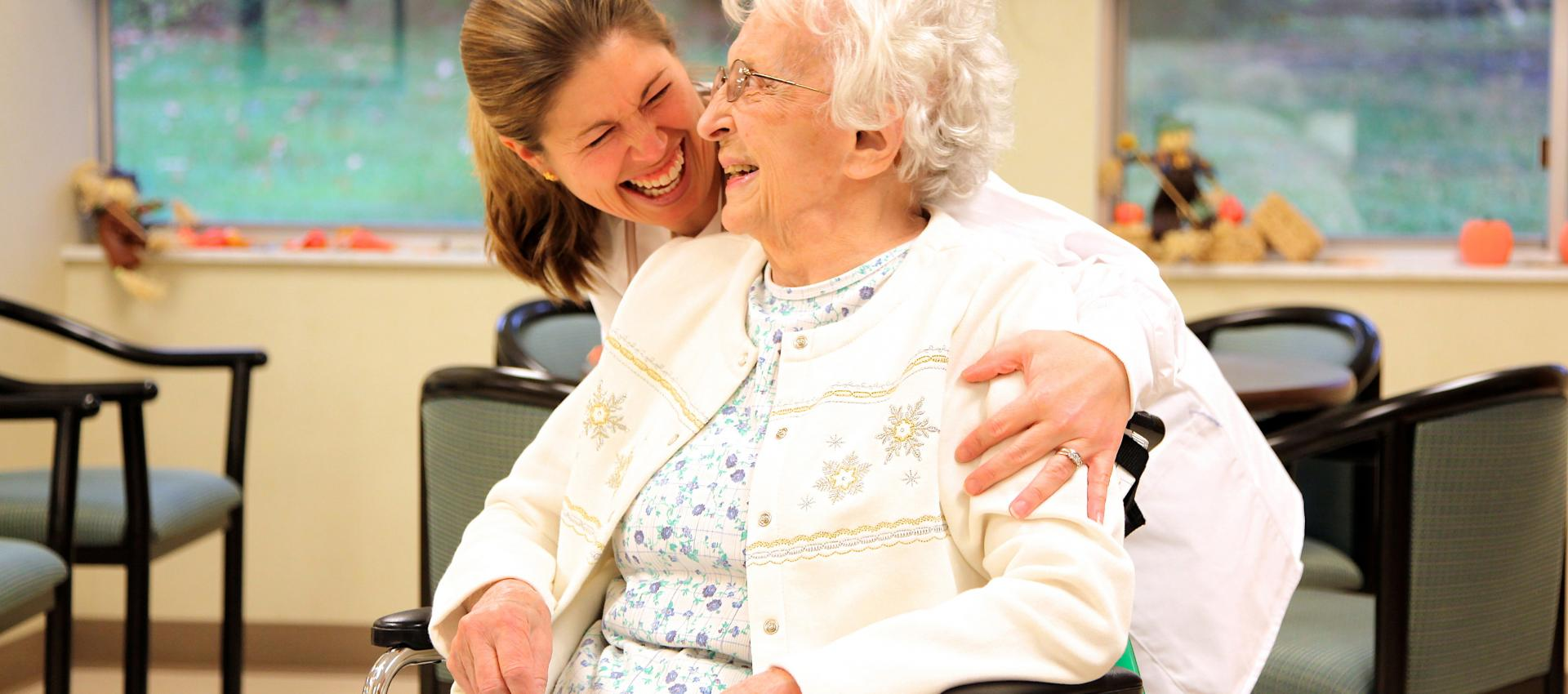 Therapist with senior in a wheelchair